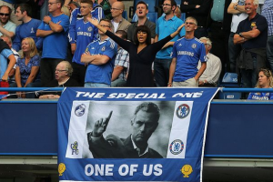 Fans celebrate the success of their club Chelsea Fc by creating a banner of the coach above (Jose Mourinho.) Mourinho is praised for leading chelsea into the top of barclays premier league table.