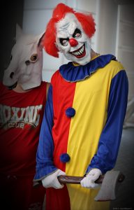 Clowns have been reported to chase people with axes and knives. Photo attribution taymtaym on Flickr.