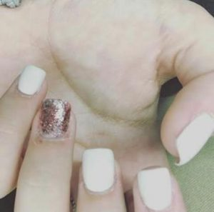 Acrylic manicures create a dense layer over the nail, which can damage one's health. Photo attribution to Esther Animalu.